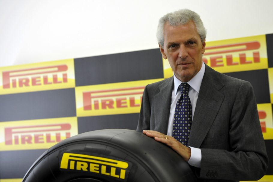 chairman of the Pirelli Group, Marco Tronchetti Provera poses with a Formula One tyre in Milan on June 24, 2010. Italian tyre manufacturer Pirelli has clinched an exclusive three-year deal to supply tyres to Formula One teams from next year, the sport's governing body FIA announced. AFP PHOTO / GIUSEPPE CACACE